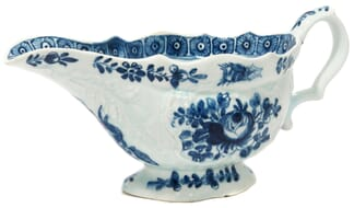 Bow sauceboat, rococo moulded with underglaze blue flowers, C. 1765 -0